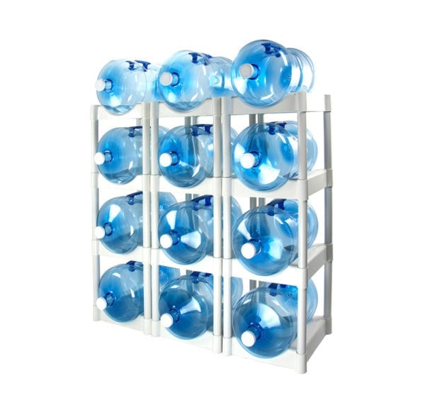 The white 12 tray Bottle Buddy storage system with 12 water jugs in each slot.