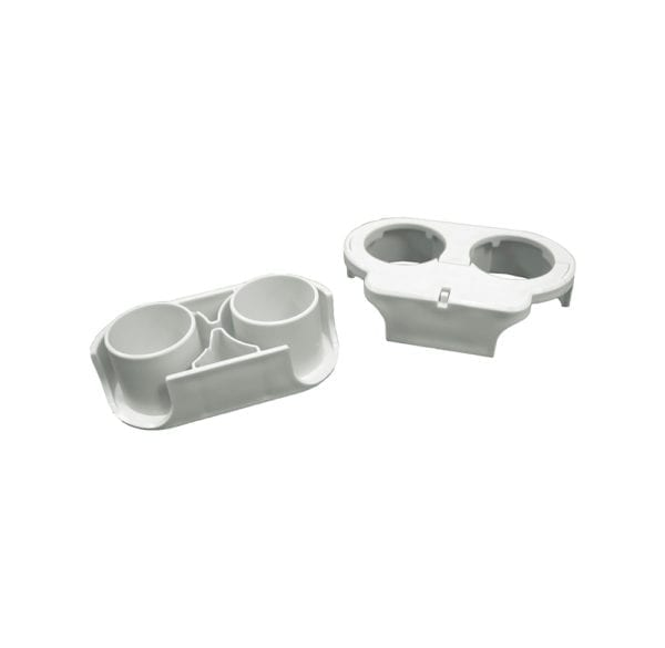 Two white Bottle Buddy connector pieces.